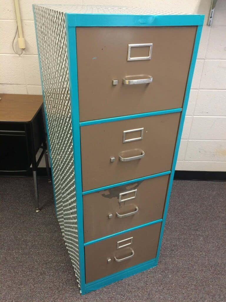 This is the middle stage of the filing cabinet makeover. Cover the cabinet with contact paper and the cover the edges with colored duct tape.