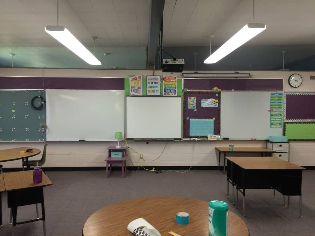 Front of classroom. Smartboard. Dry Erase boards. Calendar on dry erase board so it can be magnetic and interactive. Rhoda Studio