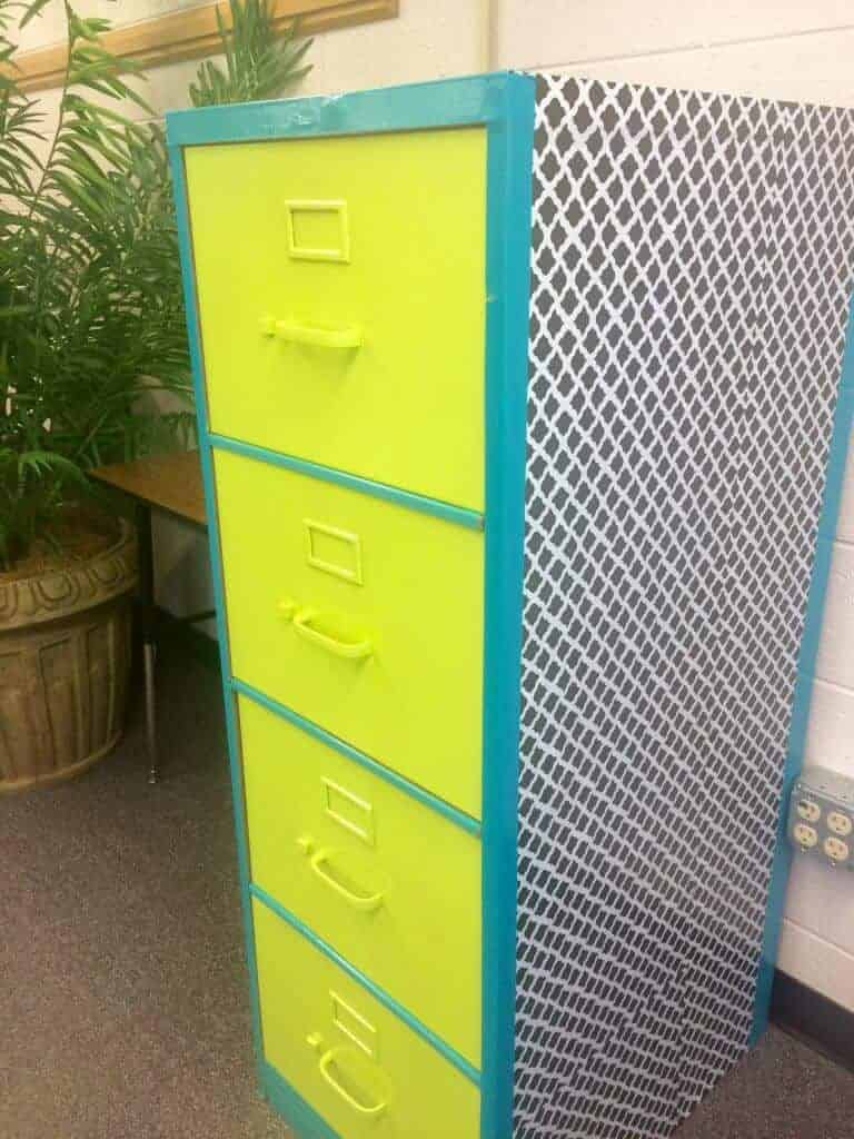 Finished filing cabinet makeover. Contact paper, duct tape, and some spray paint! Read about it on my blog :)