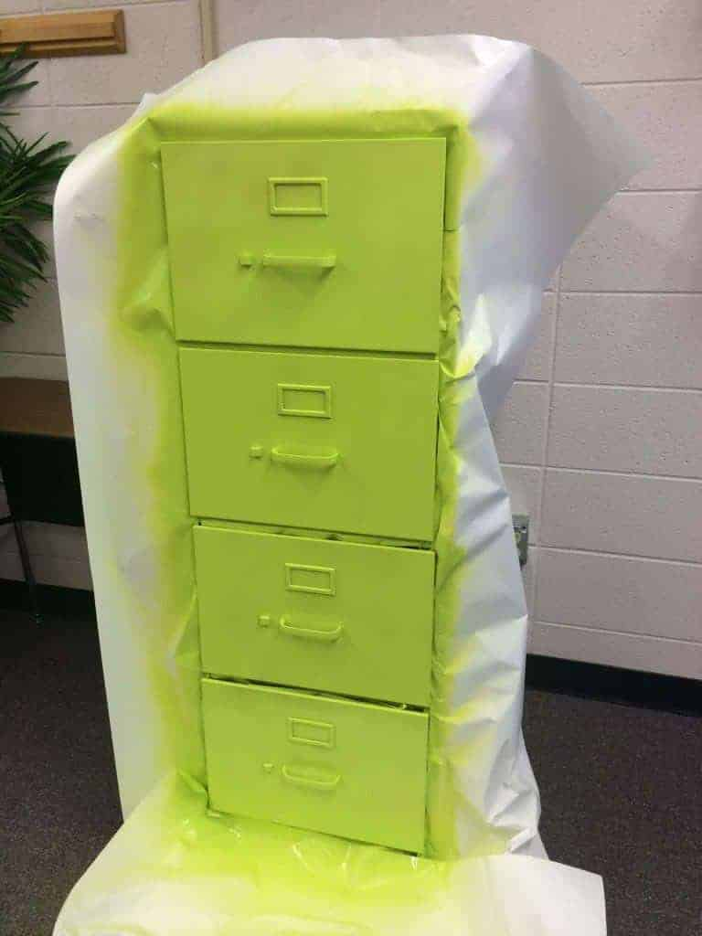 Wrap some bulletin board or butcher paper around the drawers before you paint. Filing cabinet makeover by Rhoda Design Studio