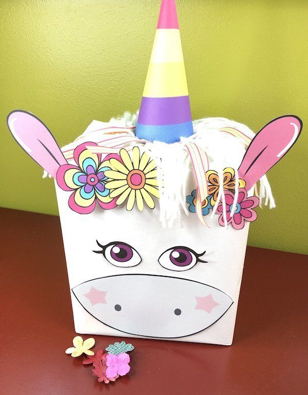 Create a whimsical and fun unicorn Valentines box for your child or students. Use the free printable to make a quick and easy unicorn craft project.
